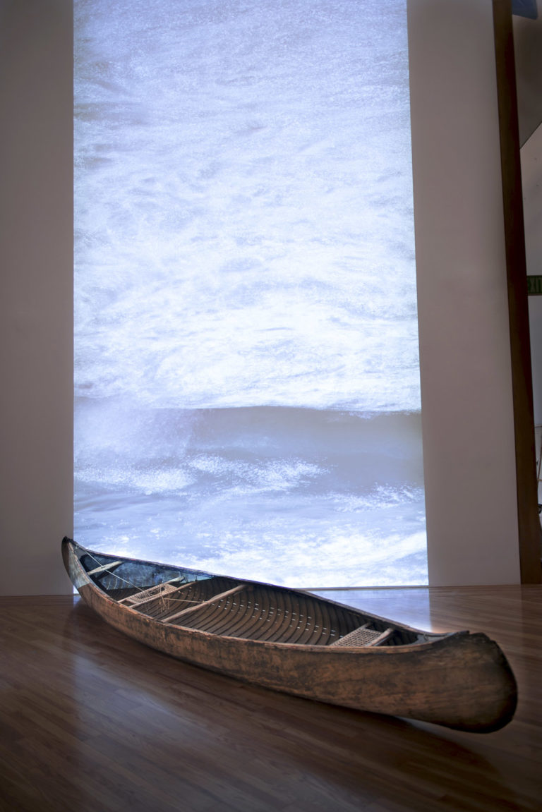 Tracind Antilles, 2013, Installation, Wooden Canoe, and video projection. Dimentions: variable. The Patricia and Phillips Frost Museum, Miami, FL.